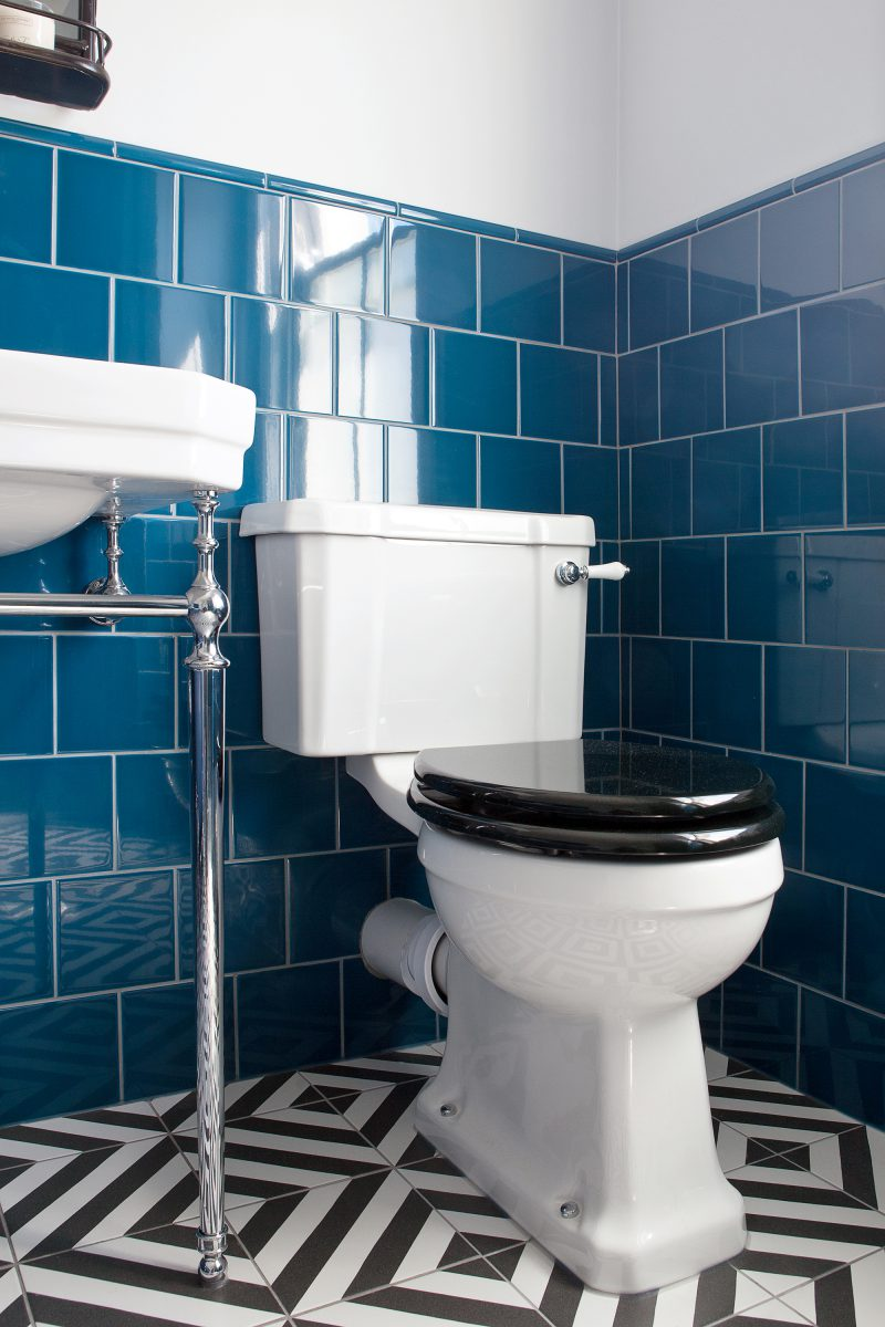 Blue Tiled Main Bathroom With Slipper Bath And Geometric