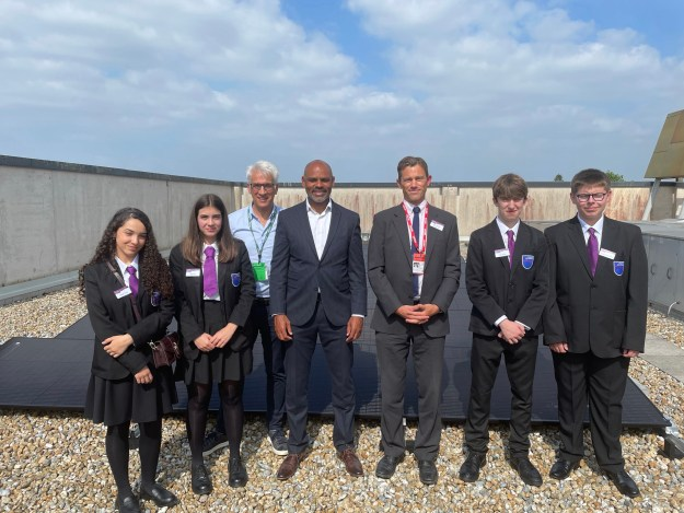 Mayor of Bristol, Marvin Rees visiting the newly installed solar panels with the student from Oasis Academy