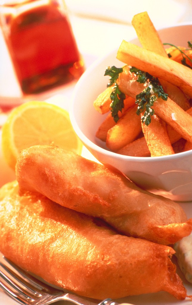 This is what the fish and chips looked like, except my meal came with a tiny turret of mushy peas-mint sauce, tartar sauce and a glass of white wine too! ©VisitBritain