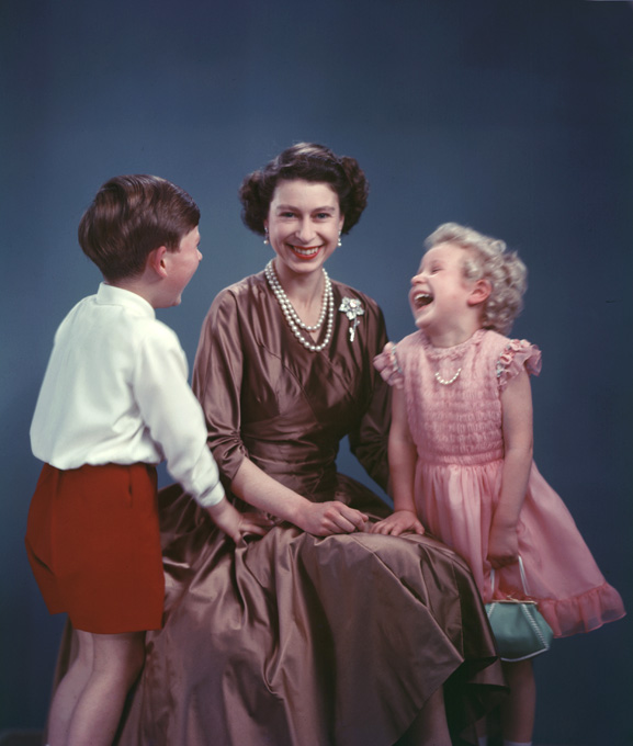 Her name is Elizabeth Alexandra Mary Windsor, also known as Elizabeth II. Along with her two eldest children - Charles - Prince of Wales & the Princess Royal - Anne!