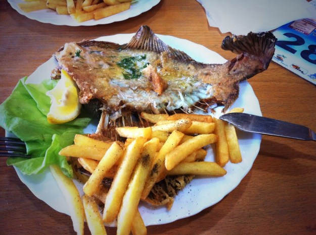 You can't go wrong with a plain and simple plate of salt and peppered thick chunky chips, with fried fish with all it's bones, and a slice of lettuce and lemon!