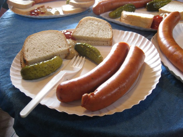 Boiled Polish sausage with brown bread, sweet mustard, ketchup and pickled cucumber or gherkin.