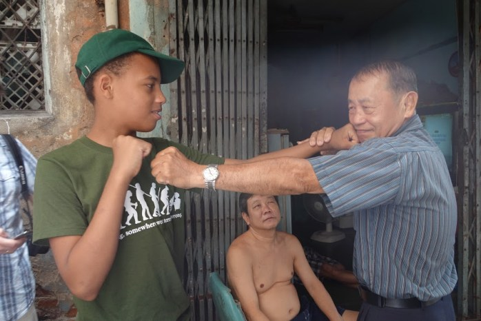 "We met an ex-Muay Thai boxer who showed ""The Tall Young Gentleman"" some of his boxing tricks!"