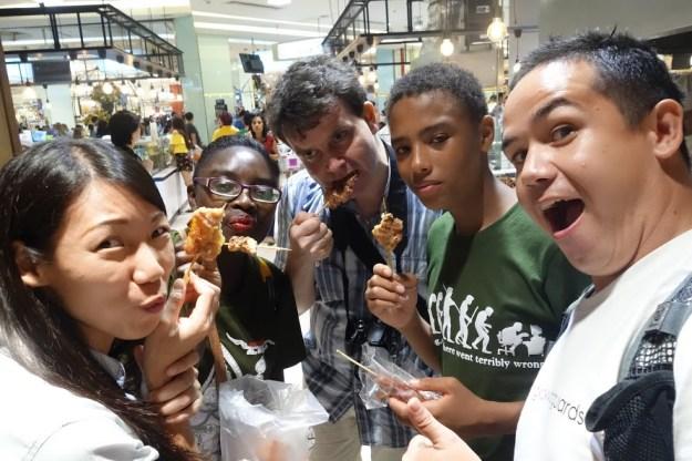 Laughing, smiling, and eating in Bangkok.