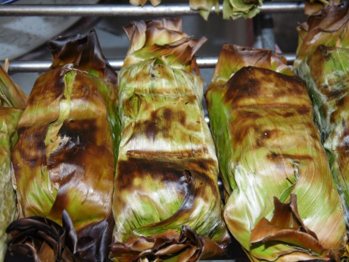 Sticky rice wrapped in banana leaf - Bangkok, Thailand.