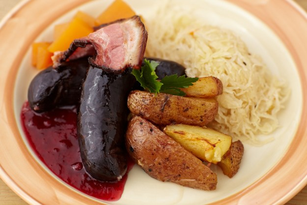 A plate of Estonian sausages at the Kuldse Notsu Korts or The Golden Piglet Inn in Tallinn, Estonia.