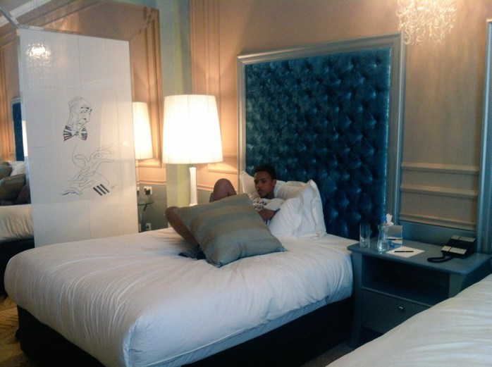 """""""The Tall Young Gentleman"""" relaxing in the the Grand Luxury Room and with 2 Full-Size Beds - Aria Hotel."""
