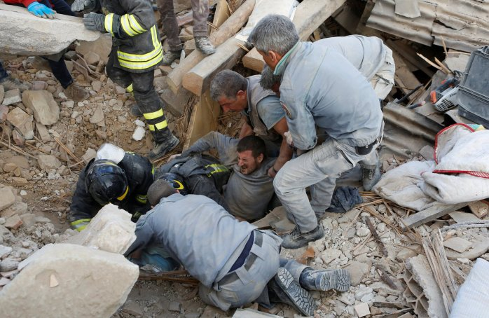 Stay calm. Help will come - A man is rescued alive from the ruins in Amatrice, Italy. ©Remo Casilli - Reuters