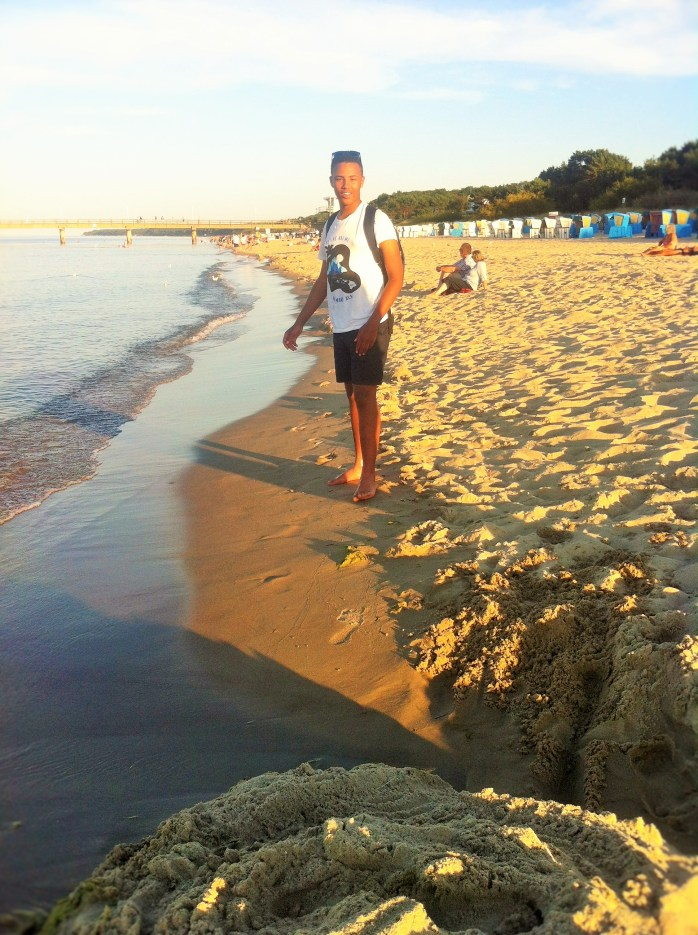 The Tall Young Gentleman trying to make a sandcastle! 51 reasons to go to the seaside. In Germany!
