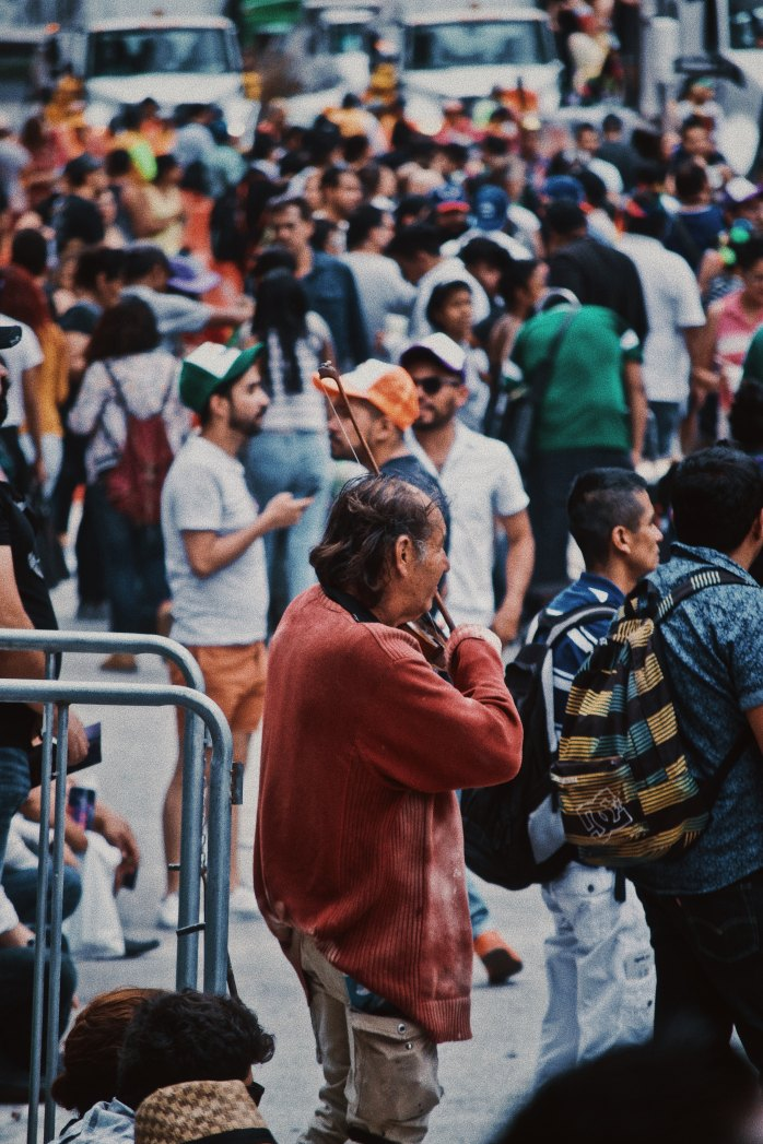 A crowded area; safety, people, city, street entertainment, scams