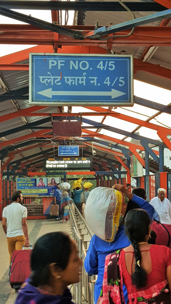 Taking the train in India; At the Delhi (Hazrat Nizamuddin) train station; Delhi (Hazrat Nizamuddin) train station; Delhi (Hazrat Nizamuddin); Delhi train station; Hazrat Nizamuddin train station; railway; Indian train; train; trains in India; Indian railway; train station; Delhi; India