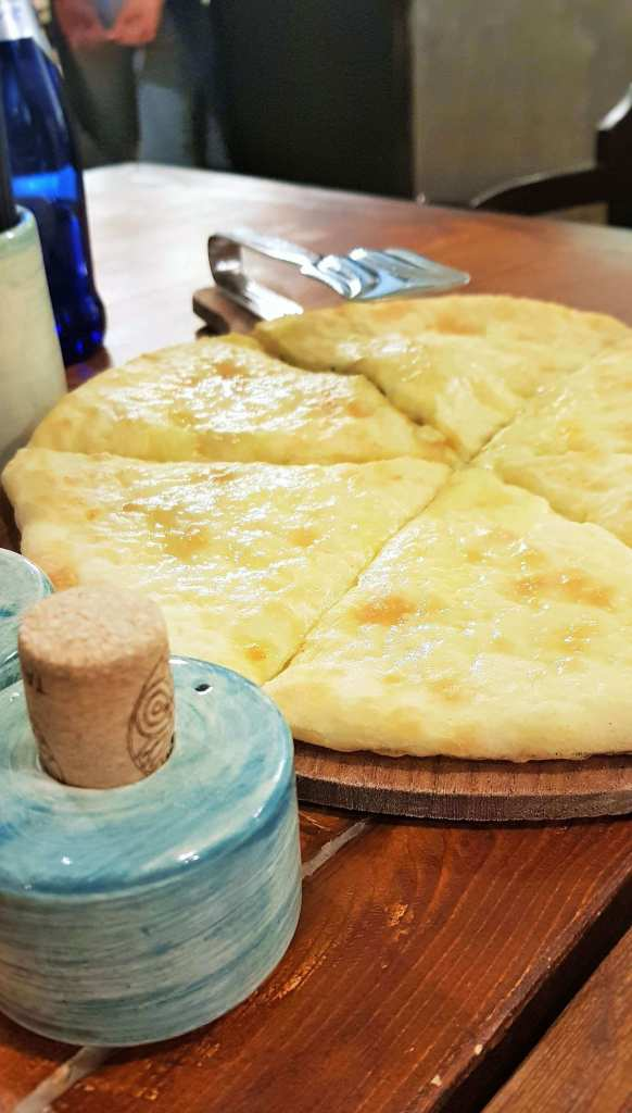 khachapuri; cheese khachapuri; bread; Georgian cheese bread; bread; pizza; Georgian pizza; cheese; Georgian cheese; vegetables; savoury food; food; Georgian food; a basic guide to food; basic guide; a basic guide to Georgian food; a basic guide to food in Tbilisi; a basic guide to food in Georgia; food guide; guide Georgia; Georgian; Tbilisi; Tbilisi City Hall; City of Tbilisi; Tbilisi food; best food in Georgia; best food in Tbilisi; best Georgian meal; Georgian meal; Georgian snack; Tbilisian snack; meal; snack; restaurant; Georgian restaurant; Tbilisi restaurant; restaurant in Tbilisi; restaurant in Georgia; Europe; travel;