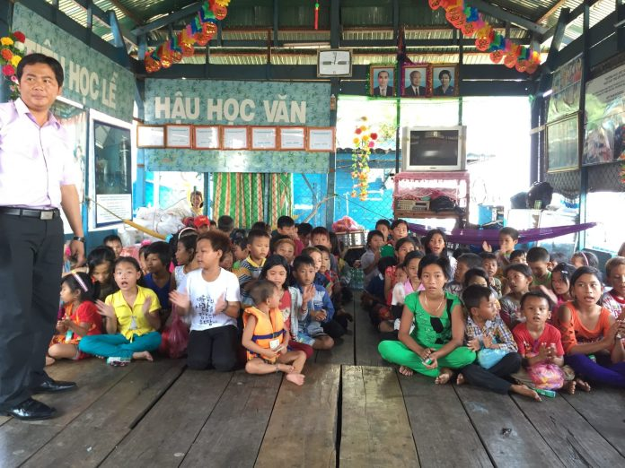Teachers work voluntarily at a charity school at Tonle Sap