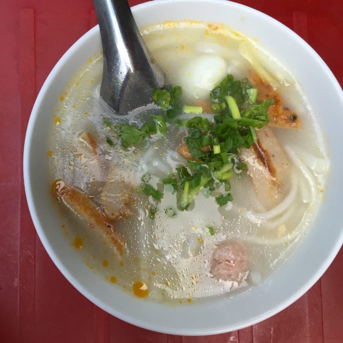 Banh Canh rice spaghetti? or cake soup? don't really know the English name but it's cheap and good also. Eaten with fried chopped fish meat.
