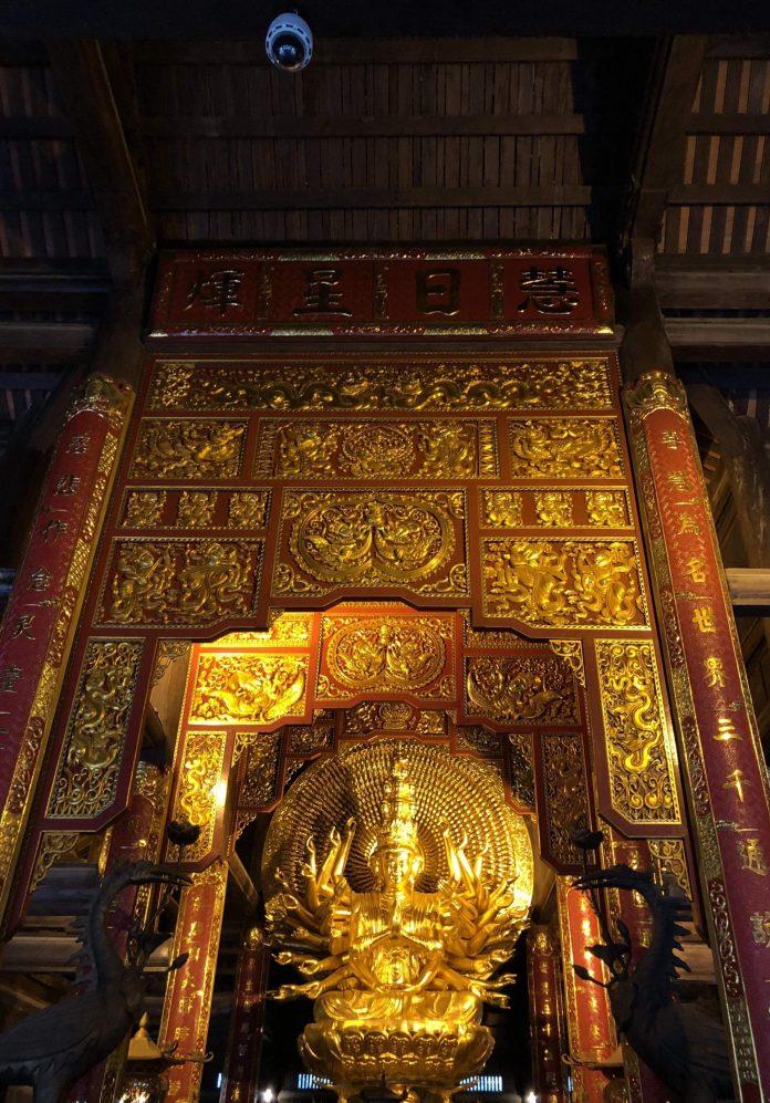 a golden Buddha statue at Bai Dinh Pagoda