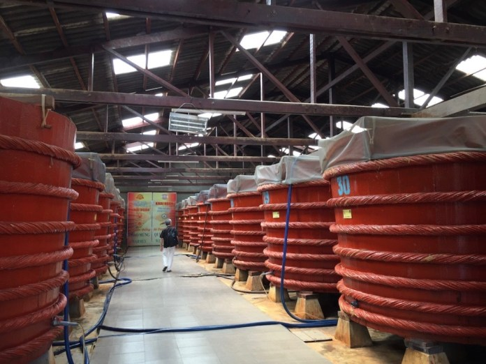 fish sauce stored in huge barrels at one manufacturer at Phu Quoc Island, Vietnam