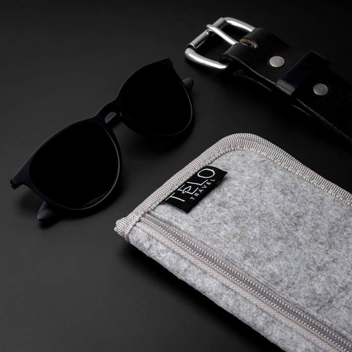 TeloTravel pill case with sunglasses and black belt