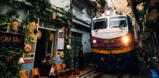 a train passing Hanoi train street