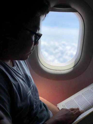Reading book for entertainment in a long-haul flight
