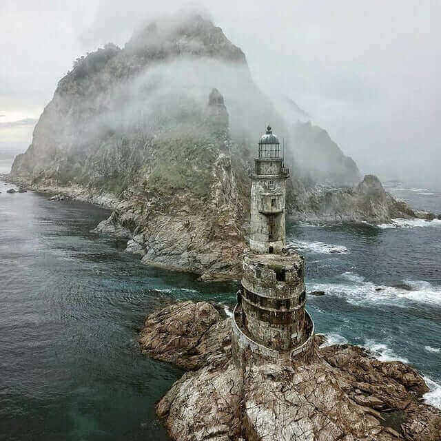 abandoned lighthouse aniva rock in sakhalin, russia
