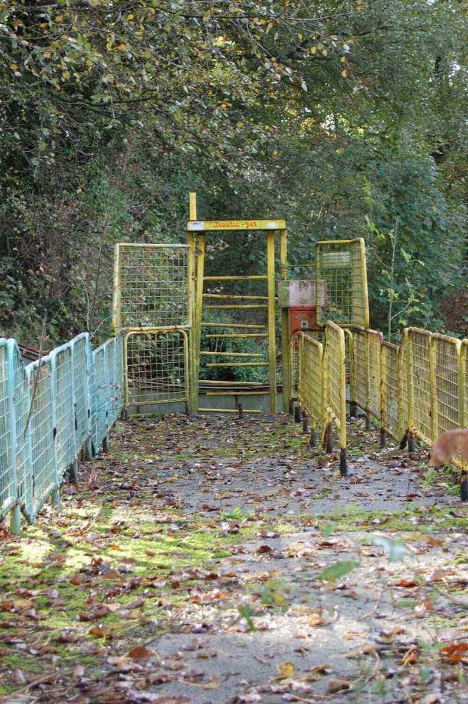 a ruined gate at dadipark, one of the abandoned amusement parks in the world