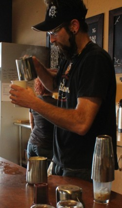 Derrick Strange, a student at COCC pouring a latte for a customer.  Photo by Vera Holiday | The Broadside.