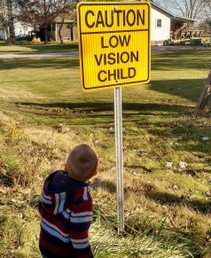 low vision child sign
