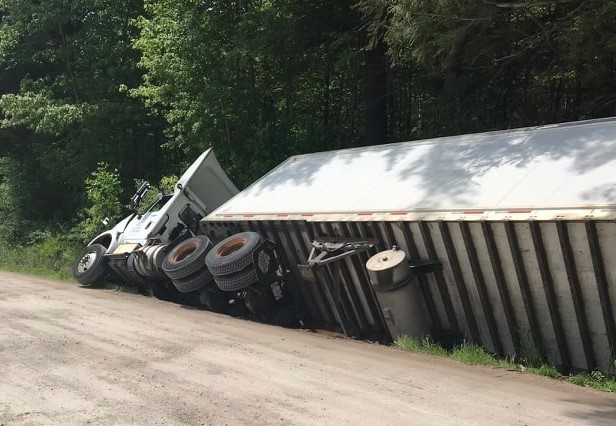 No injuries reported after transport truck rolls over into ditch