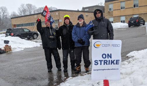 Striking teachers picket in front of Brock High School
