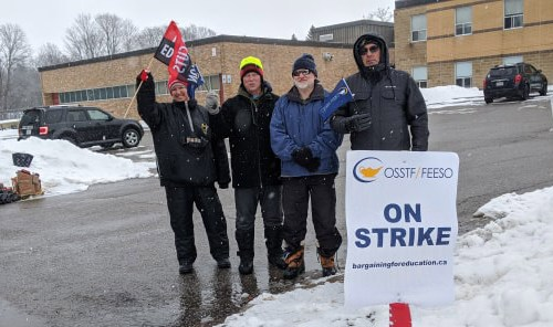 Striking teachers picket in front of Brock High School