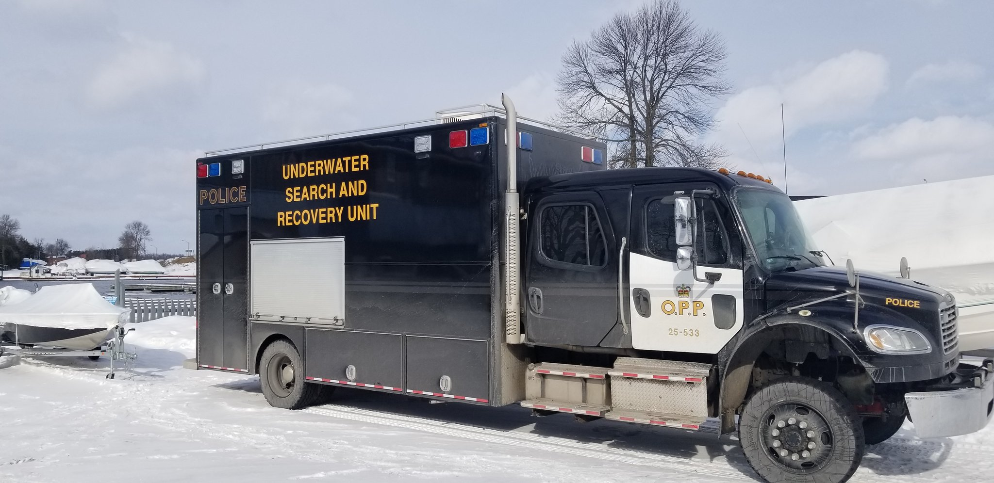 Snowmobiler found dead by police divers