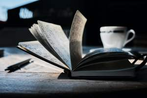 open book on brown wooden table