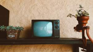 black crt tv on black wooden table