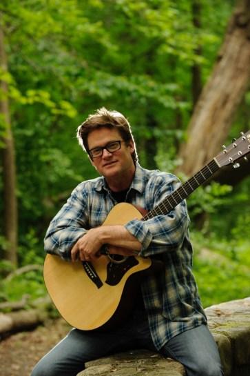Don Lowe Hugging his guitar