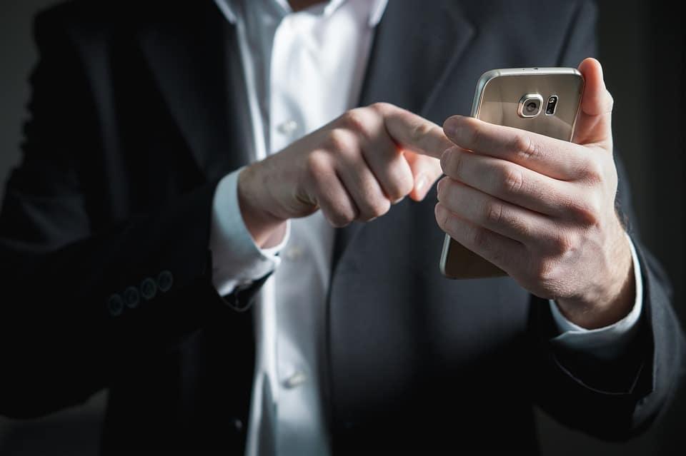 Guy Using Samsung Smartphone