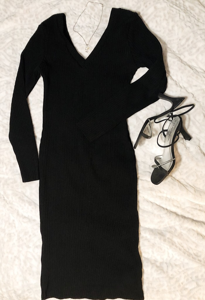 https://femmeluxefinery.co.uk/products/black-ribbed-v-neck-midi-jumper-dress-ivy