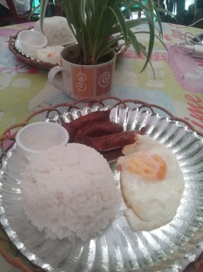 Longganisa with fried egg for breakfast