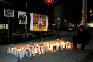 Buffalo State students placed candles outside the Campbell Student Union during a vigil Feb. 21 to honor Bradley Doyley, who died unexpectedly Feb. 18. (Photo courtesy of Dave DeLuca, The Record)