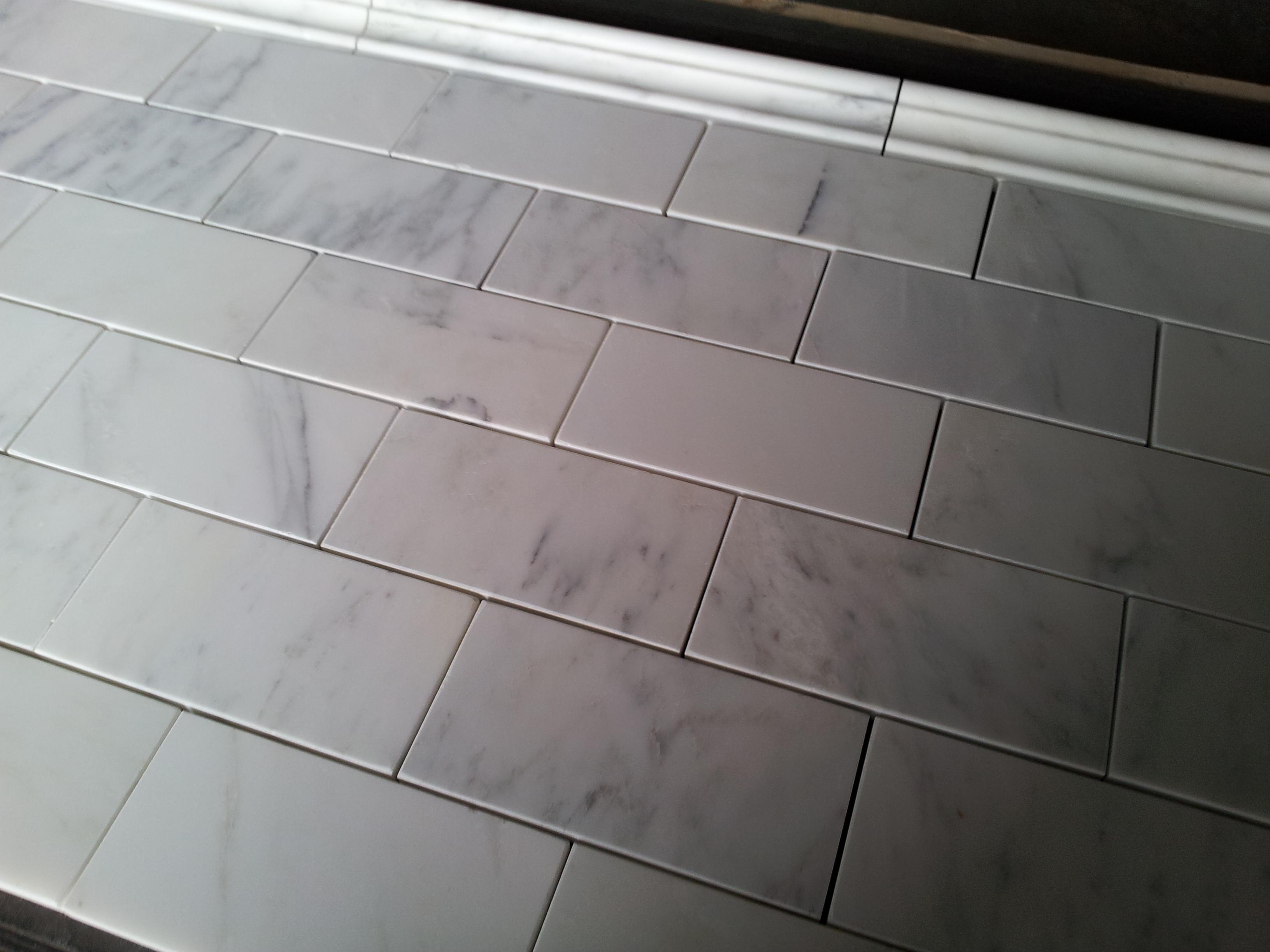 lowes chair rail tile outdoor covers walmart carrara marble subway home decor