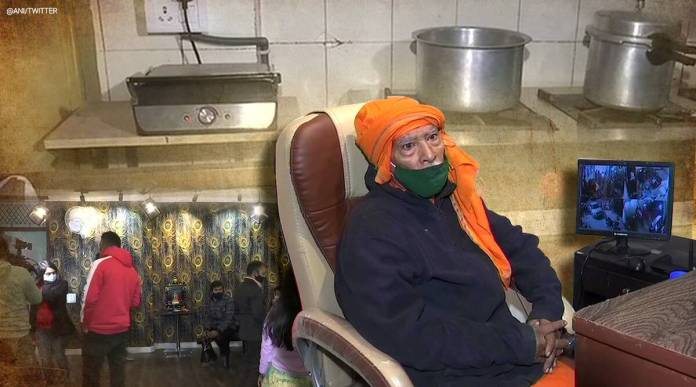 baba sitting in his new restaurant