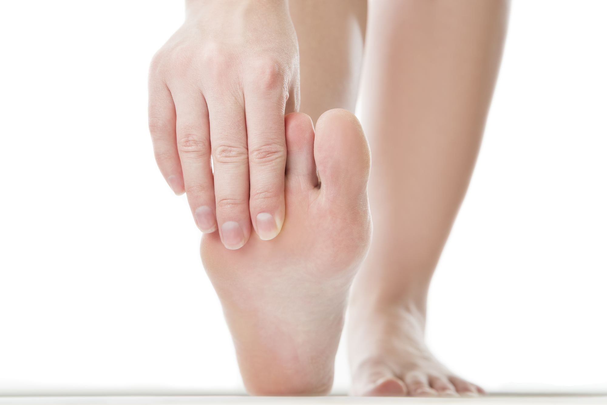 a person asks what is a bunionette and massages their painful foot