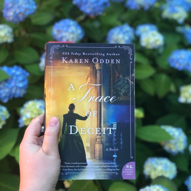 Book cover of a Trace of Deceit by Karen Odden