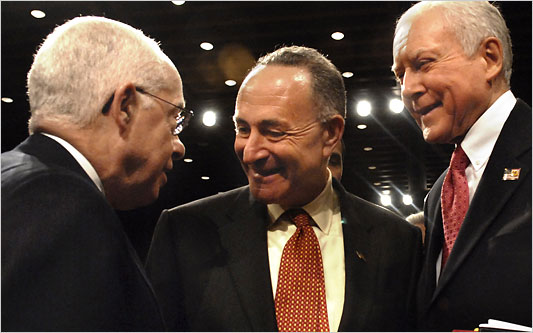 U.S. Immigration Reform bill architects Sen. Orin Hatch (R-Oklahoma) and Sen. Charles Schumer (D-NY) greet former U.S. Attorney General Michael Mukasey. (Google Images)
