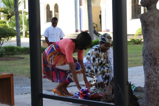 U.S. First Lady Michelle Obama lays flowers on the memorial of the victims of the 1998 embassy bombing with Tanzania's First Lady Salma Kikwete. (Google Images)