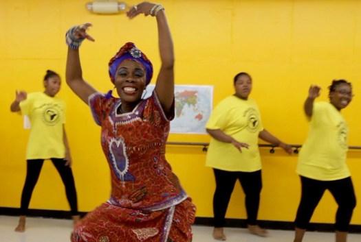 The Founder of the Kúkátónón Organization Liberian Native Rolia Manyongai-Jones performing dance. (Photo Credit: http://www.opb.org)