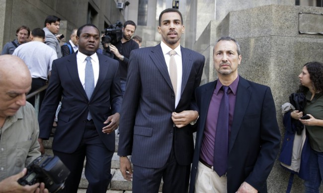 Thabo Sefolosha, center, leaves criminal court in New York, Friday, Oct. 9, 2015. The Atlanta Hawks' player was acquitted Friday in a case stemming from a police fracas outside a trendy New York City nightclub. (AP Photo/Seth Wenig) ORG XMIT: NYSW103