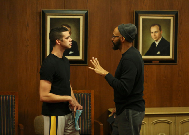 ABC's 'American Crime' executive producer and showrunner John Ridley (r.) converses with series co-star Joey Pollari (Eric Tanner) (l.) (Photo Credit: Ryan Green/ABC).