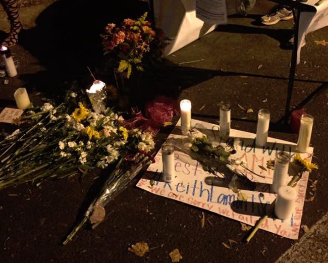 Charlotteans leave flowers and candles for Kenneth Lamont Scott who was killed by Charlotte-Mecklenburg Police officers. (Photo: Calvin Walton)
