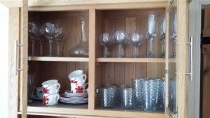glasses cabinet in a holiday rental need sorting