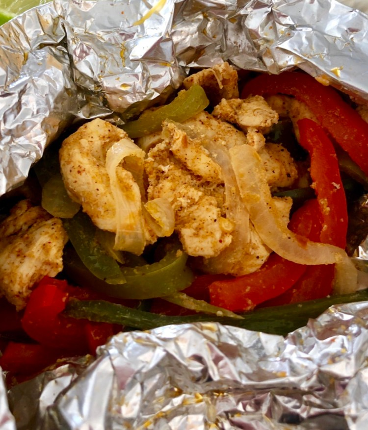Fajitas in foil packets with Mexican marinated chicken